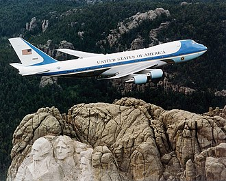 Air Force One - SAM 28000, one of the two VC-25s used as Air Force One, flying over Mount Rushmore in February 2001