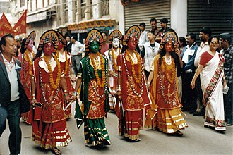 Nepal Sambat - Actors dressed up as Ajima mother goddesses take part in New Year's Day parade in Kathmandu.