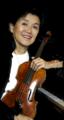 Akye Agus with violin at piano 2B.png