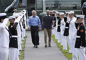 Mohammed bin Zayed Al Nahyan - President of the United States George W Bush walks with Al-Nahyan through an honour guard upon his arrival at Camp David in June 2008