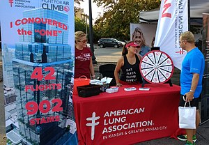 An American Lung Association booth at a local 5k race in Kansas City.