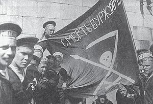 "Stepan Maximovich Petrichenko - Sailors of the Petropavlovsk in Helsinki, before the Finnish Civil War (Summer 1917); Flag calls for ""death to the bourgeoisie""."