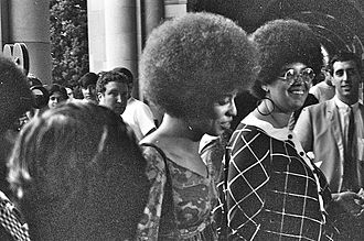 Angela Davis - Angela Davis (center, no glasses) enters Royce Hall at UCLA in October 1969 to give her first lecture.
