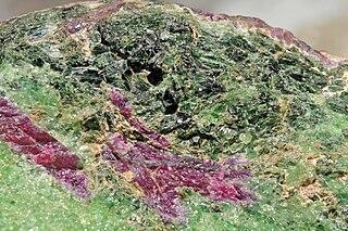 Tschermakite amphibole, double chain inosilicate mineral