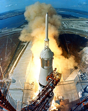 Apollo 11 - Saturn V carrying Apollo 11 rises past the launch tower camera