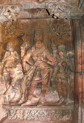 Ardhanarishvara - Ardhanarishvara playing a veena surrounded by Bhringi and a female attendant, Badami