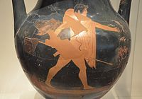 Attic red-figure amphora depicting Theseus wearing chlamys and petasos walking to the right and holding a spear, about 470 BC, National Archaeological Museum of Athens (14091950516).jpg