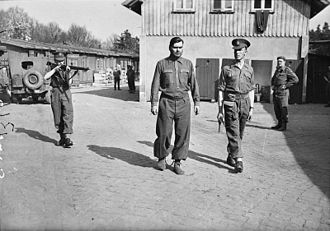 Josef Kramer - Josef Kramer, photographed in leg irons at Belsen before being removed to the POW cage at Celle, 17 April 1945.