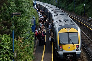 Belfast suburban rail - Bangor West with commuters alighting from the train.