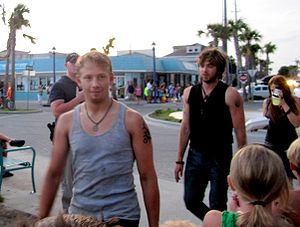 The Last Song (film) - From left to right, cast members Adam Barnett, Nick Lashaway, and Carly Chaikin make their way to the filming of the bonfire scene under the Tybee Island pavilion on July 30, 2009.