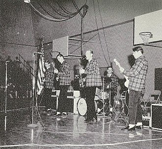 The Beach Boys - The Beach Boys, in Pendleton outfits, performing at a local high school, late 1962.
