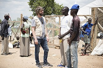 Benson Taylor - Taylor speaking with South Sudanese refugees at the Bidi Bidi Refugee Settlement in Uganda with the United Nations World Food Programme.