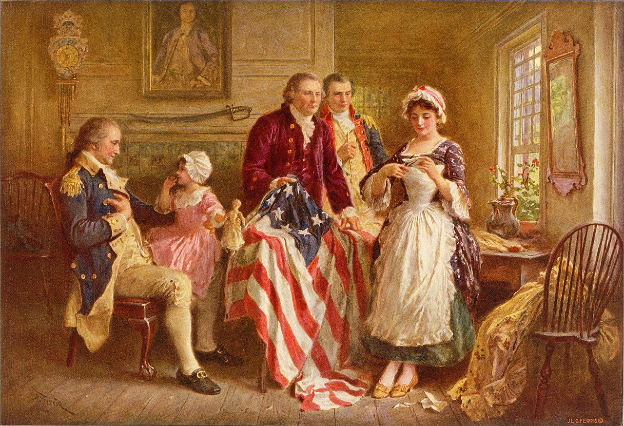 Image of Betsy Ross stitching the Betsy Ross flag.