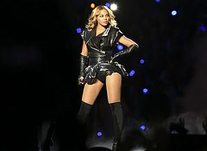 Super Bowl XLVII halftime show - Beyoncé wearing an oversized black jacket over a lace-and-leather bodysuit, and thigh-high stockings for the halftime show.