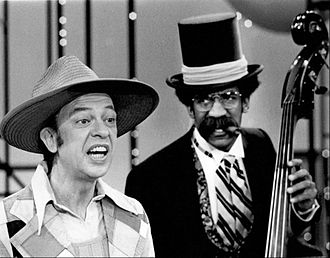 The New Bill Cosby Show - Guest star Don Knotts sings while Cosby provides the music in a skit from the show in 1973.