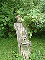 Birdhouses on a stump (8203934056).jpg