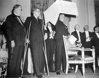 Basil O'Connor - O'Connor (left) looks on as FDR is presented with a $1 million check, the proceeds of the first national President's Birthday Ball (1934)