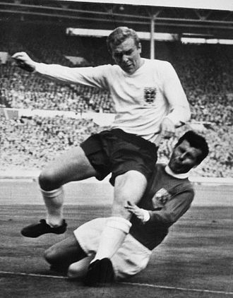 Bobby Moore - Moore (left) vs. Josef Masopust at the 1963 England v Rest of the World football match.