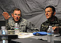 Brazilian military Gen. Floriano Peixoto, commander of United Nations Stabilization Mission in Haiti, receives a brief from U.S. Soldiers with the 2nd Brigade Combat Team, 82nd Airborne Division March 11, 2010 100311-N-HX866-003.jpg