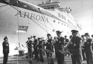 "Muss i denn - An orchestra in Rostock playing ""Muß i denn, muß i denn ..."" at the pier as a farewell to German icebreaker Arkona on its maiden trip to Leningrad and Riga. 15 October 1985."