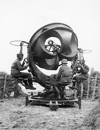 Acoustic location - Sound location equipment in Germany, 1939. It consists of four acoustic horns, a horizontal pair and a vertical pair, connected by rubber tubes to stethoscope type earphones worn by the two technicians left and right. The stereo earphones enabled one technician to determine the direction and the other the elevation of the aircraft.