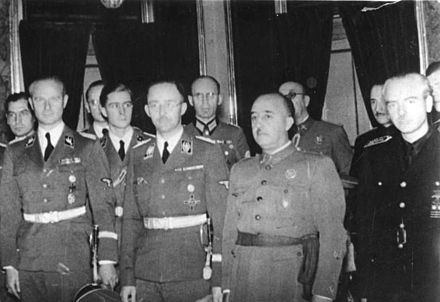 Front row in order from left to right: Karl Wolff, Heinrich Himmler, Franco and Spain's Foreign Minister Serrano Suner in Madrid, October 1940 Bundesarchiv Bild 183-L15327, Spanien, Heinrich Himmler bei Franco.jpg