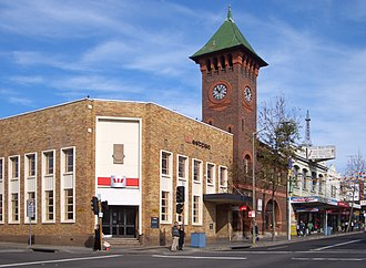 Burwood, New South Wales - Burwood Road. The brick tower is part of Burwood Post Office (designed by government architect Walter Liberty Vernon).