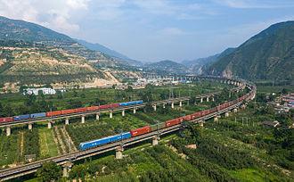 Longhai railway - Two HXD1-hauled freight trains meet near Yuanlong station in Tianshui, Gansu
