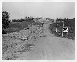 Civil Works Administration - CWA project in Minnesota to straighten a road by removing a solid rock obstruction (c. 1934)
