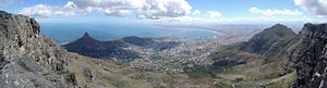 Table Mountain - Panorama from the top of Table Mountain. From left to right are visible Lion's Head, Signal Hill, Robben Island, the Cape Town city centre, Table Bay, and Devil's Peak.