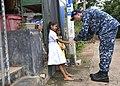 Capt. Darren McPherson gives Sri Lankan children a low-five. (35154949791).jpg