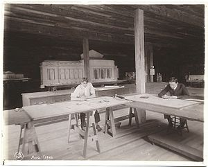 Carrère and Hastings - Architects at work at Carrère and Hastings studio, 1905, with a model of the New York Public Library Main Branch, designed by the firm, behind them