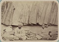 Central Asian Men's Clothing. Selling Gowns at a Bazaar WDL10763.png