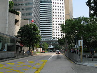 Chater Road - Eastern section of Chater Road. The Hong Kong Club Building is on the left, and Chater Garden on the right.