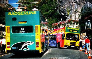 Open top buses in Weston-super-Mare - Leyland Olympian 8613 in Badgerline fleet livery and 8609 in Cheddar Showcaves advertising livery in the 1990s
