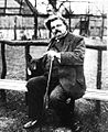 Chesterton Sitting with a Dog.jpg