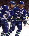 Chris Higgins & Henrik Sedin (16766135677).jpg