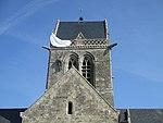Church tower of Église de Sainte-Mère-Église (1).jpg
