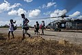 Civilians exit a U.S. Navy MH-60S Seahawk helicopter assigned to Helicopter Sea Combat Squadron (HSC) 12 in Guiuan, Eastern Samar province, Philippines, after being airlifted from an affected area of 131115-N-BD107-375.jpg