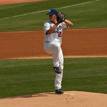 Clayton Kershaw pitching for the Los Angeles D...