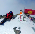 Climber on the summit of Lenin Peak.png
