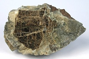 Clintonite - Clintonite with spinel on orthoclase matrix from Amity, New York (size: 9.3 x 5.7 x 3.8 cm)