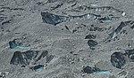Close-up of lower Tasman Glacier and pools of melting glacial water.jpg