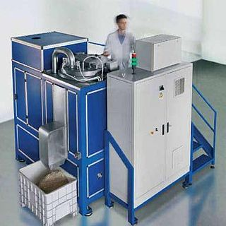 Waste converter machine used for the treatment and recycling of solid and liquid refuse material