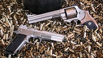 10mm Auto - The Bren Ten (left) and Smith & Wesson Model 610 Classic (right), 1983.