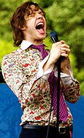 aff8dbbc0a0 Indie rock singer Damian Kulash wearing psychedlic 1960s inspired clothing