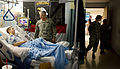 Defense.gov News Photo 110121-A-0193C-012 - U.S. Army Chief of Staff Gen. George W. Casey Jr. talks with a soldier while medical staff stand by at Brooks Army Medical Center at Fort Sam.jpg