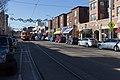 Delmar Blvd west of Limit Ave in University City with Loop Trolley car, Dec. 2018.jpg