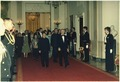 Deng Xiaoping, Jimmy Carter, Madame Zhuo Lin and Rosalynn Carter on their way to the state dinner for the Vice... - NARA - 183225.tif