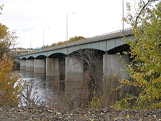 The upstream side of the Dexter Coffin Bridge pictured from Windsor Locks, Connecticut